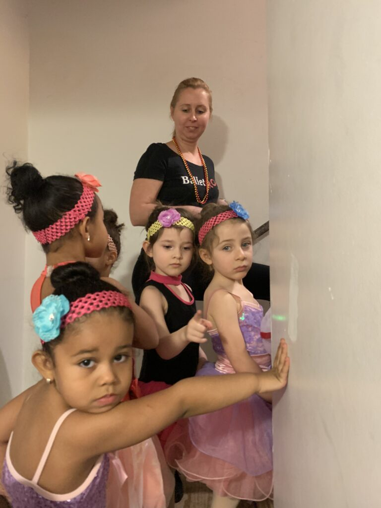 Kids posed for a photo with their BalletRox instructor at an event.